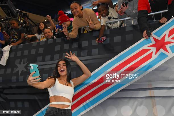Tiki's Tok Star Dixie D'Amelio takes a selfie with fans during Practice and Media Availability presented by ATT as part of 2020 NBA AllStar Weekend...