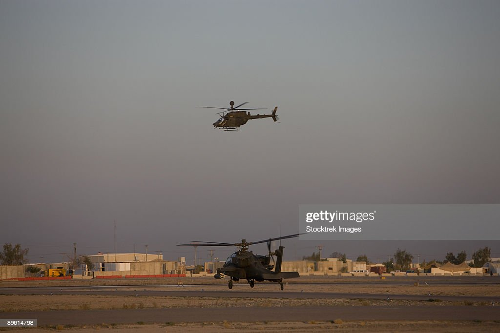 Tikrit, Iraq - An AH-64 Apache Helicopter waits for a OH-58 Kiowa to clear his flight space. : Stock Photo