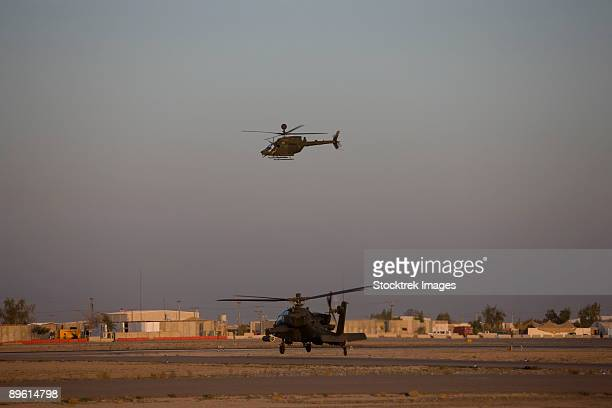 Tikrit, Iraq - An AH-64 Apache Helicopter waits for a OH-58 Kiowa to clear his flight space.