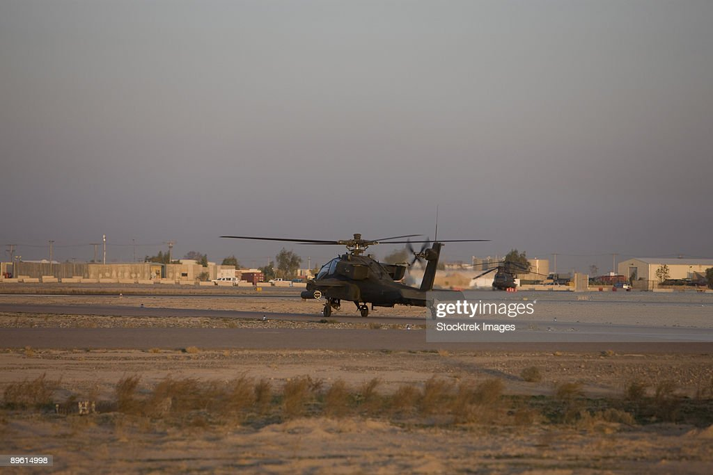 Tikrit, Iraq - An AH-64 Apache waits for clearance from the flight tower on Camp Speicher. : Stock Photo