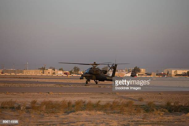 Tikrit, Iraq - An AH-64 Apache waits for clearance from the flight tower on Camp Speicher.