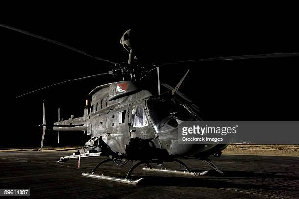 tikrit, iraq - an oh-58d kiowa sits on its pad at night. - helicopter rotors stock photos and pictures