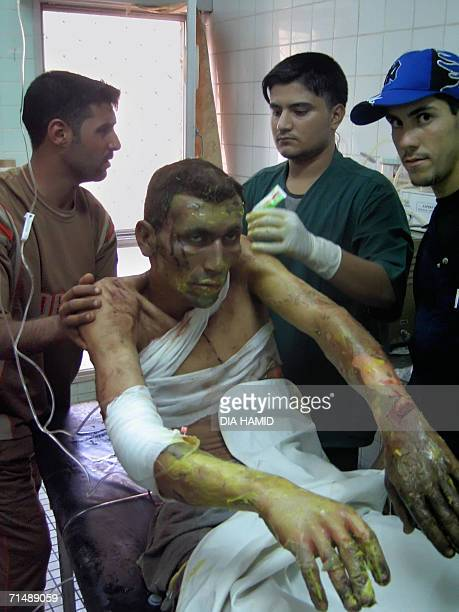 Iraqis treat a wounded man at a hospital in the northern city of Tikrit 20 July 2006 At least four people were killed and 12 wounded when a car bomb...