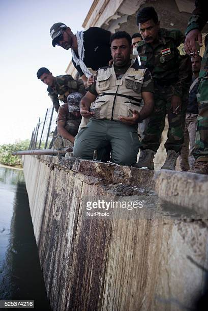 Tikrit Iraq on April 5 2105 A member of Hashed Al Shabee prays where the blood fell of Iraqi soldiers from camp Speicher were slaughtered here before...
