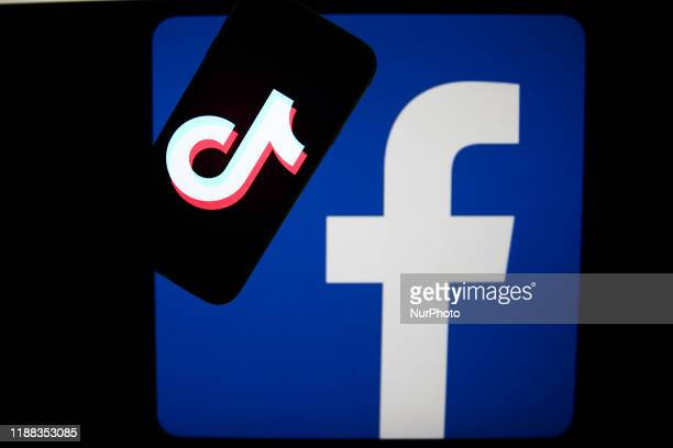 TikTok and Facebook logos are seen displayed on a screens in this illustration photo taken in Krakow Poland on December 9 2019