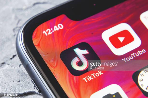 tiktok and youtube apps on screen iphone xr, close up - tiktok stock photos and pictures