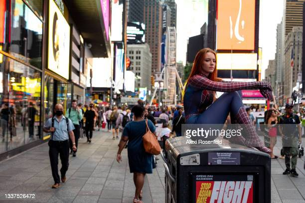 TikTok celebrity Halcybella dressed as Spider-Man takes photos in Times Square on August 31, 2021 in New York City.