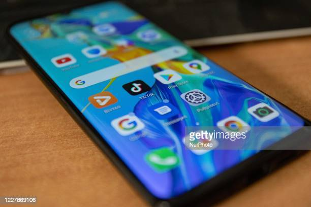 TikTok closeup logo displayed on a phone screen, smartphone and keyboard are seen in this multiple exposure illustration. Tik Tok is a Chinese...