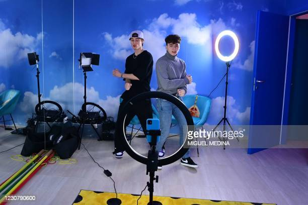 """TikTok influencers Marco Bonetti and Davide Moccia perform a video in the """"Defhouse"""", a TikTok influencers incubator in Milan, on January 21, 2021. -..."""