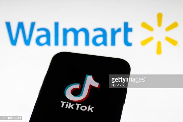 TikTok logo displayed on a phone screen is seen with Walmart logo in the background in this illustration photo taken on September 21, 2020 in Krakow,...