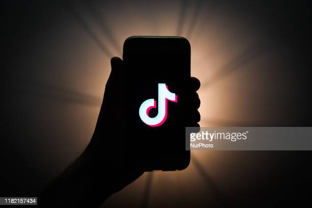TikTok logo is seen displayed on a phone screen in this illustration photo taken in Krakow, Poland on November 13, 2019.