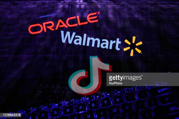 TikTok, Oracle and Walmart logos displayed on a screens and a keyboard are seen in this multiple exposure illustration photo taken on September 21,...