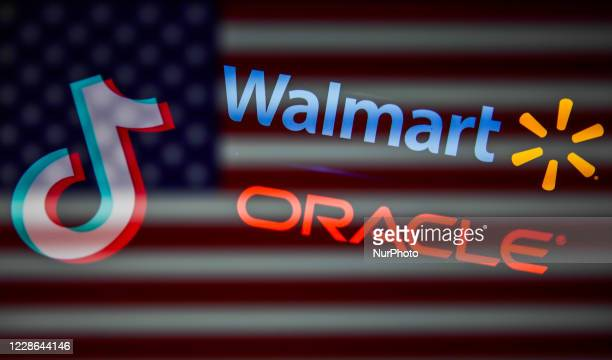 TikTok, Oracle and Walmart logos displayed on a screens and American flag are seen in this multiple exposure illustration photo taken on September...