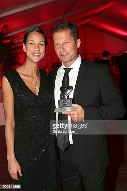 Til Schweiger and his girlfriend Marlene Shirley with award during the Ein Herz Fuer Kinder gala 2015 after show party at Borchardt Restaurant on...