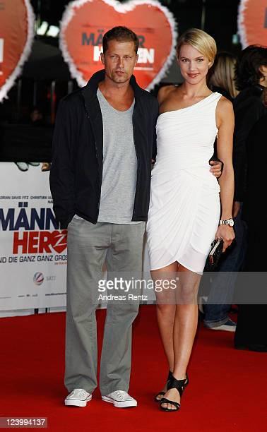 Til Schweiger and partner Svenja Holtmann attend the 'Maennerherzen 2 und die ganz grosse Liebe' premiere at CineStar on September 7 2011 in Berlin...