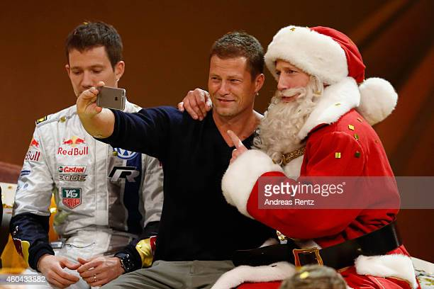 Til Schweiger and Wotan Wilke Moehring dressed as Santa Claus pose for a selfie during the last broadcast of the Wetten dass tv show on December 13...