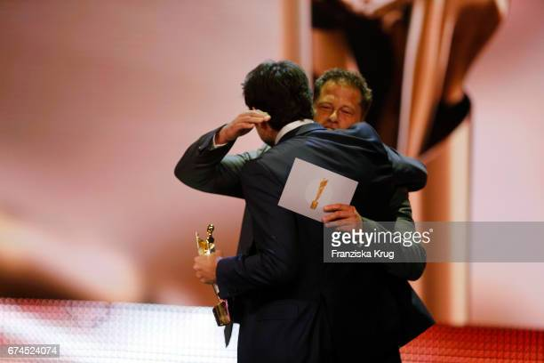 Til Schweiger hugs Simon Verhoeven on stage before giving him his award for Largest Audience at the Lola German Film Award show at Messe Berlin on...