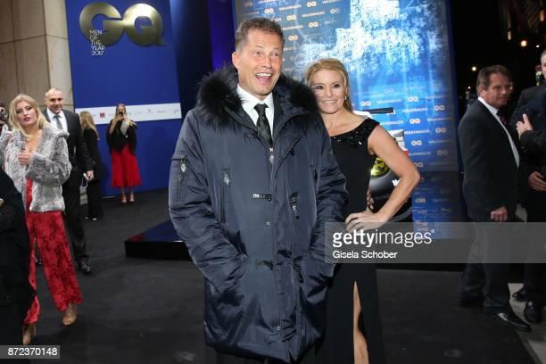 Til Schweiger photobombs Arnold Schwarzenegger and his girlfriend Heather Milligan during the GQ Men of the year Award 2017 at Komische Oper on...
