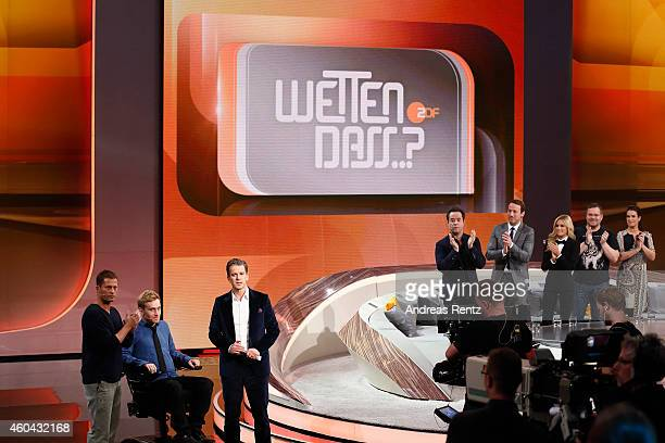 Til Schweiger Samuel Koch and TV host Markus Lanz are seen on stage at the last broadcast of the Wetten dass tv show on December 13 2014 in Nuremberg...