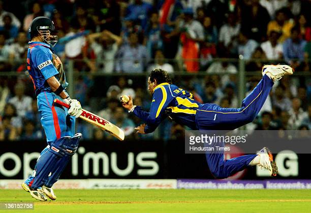 Tilakratne Dilshan of Sri Lanka takes a catch off Indian batsman Virat Kohli during the 2011 ICC World Cup final between India and Sri Lanka at...