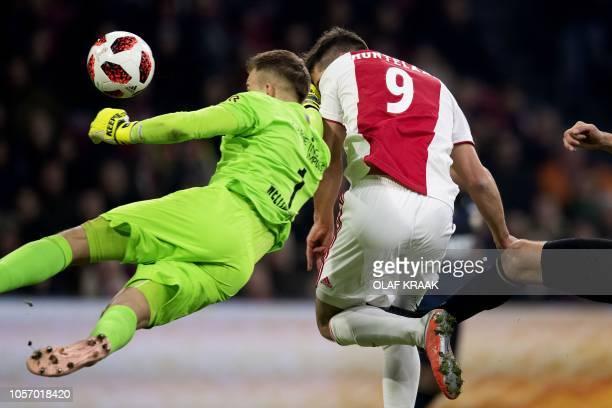 Tilburg's German goalkeeper Timon Wellenreuther vies with Ajax' Dutch forward Klaas Jan Huntelaar during the Dutch Eredivisie football match between...