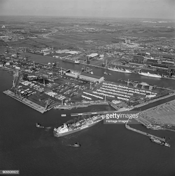 Tilbury Dock Thurrock Essex 1981 A container ship being pulled into port by three tug boats Artist Aerofilms