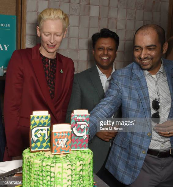 Tilda Swinton Ahsan Akbar and K Anis Ahmed attend the launch of Teatulia Tea Bar in Covent Garden on September 13 2018 in London England