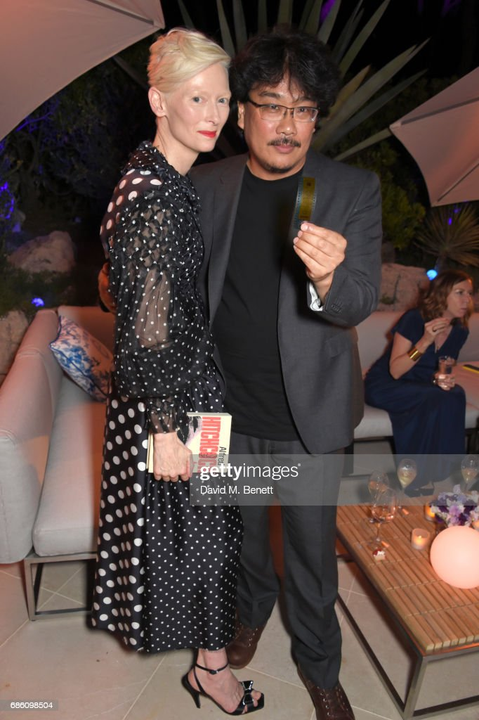 Tilda Swinton (L) and Bong Joon-ho attend the Vanity Fair and Chopard Party celebrating the Cannes Film Festival at Hotel du Cap-Eden-Roc on May 20, 2017 in Cap d'Antibes, France.