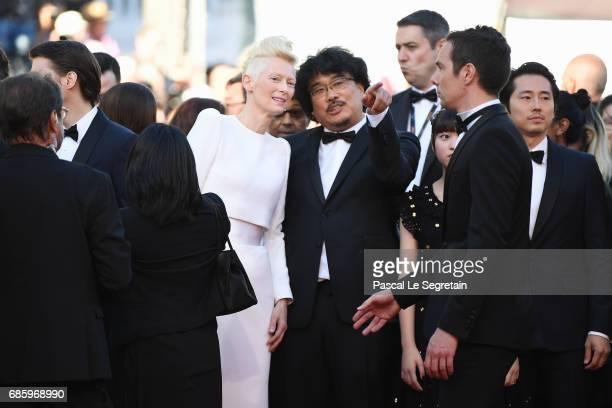 Tilda Swinton and director Bong JoonHo attend the 'Okja' screening during the 70th annual Cannes Film Festival at Palais des Festivals on May 19 2017...
