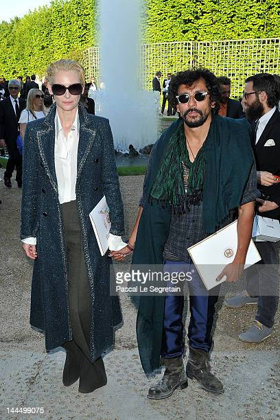 Tilda Swinton and fashion designer Haider Ackermann attend the Chanel 2012/13 Cruise Collection at Chateau de Versailles on May 14 2012 in Versailles...