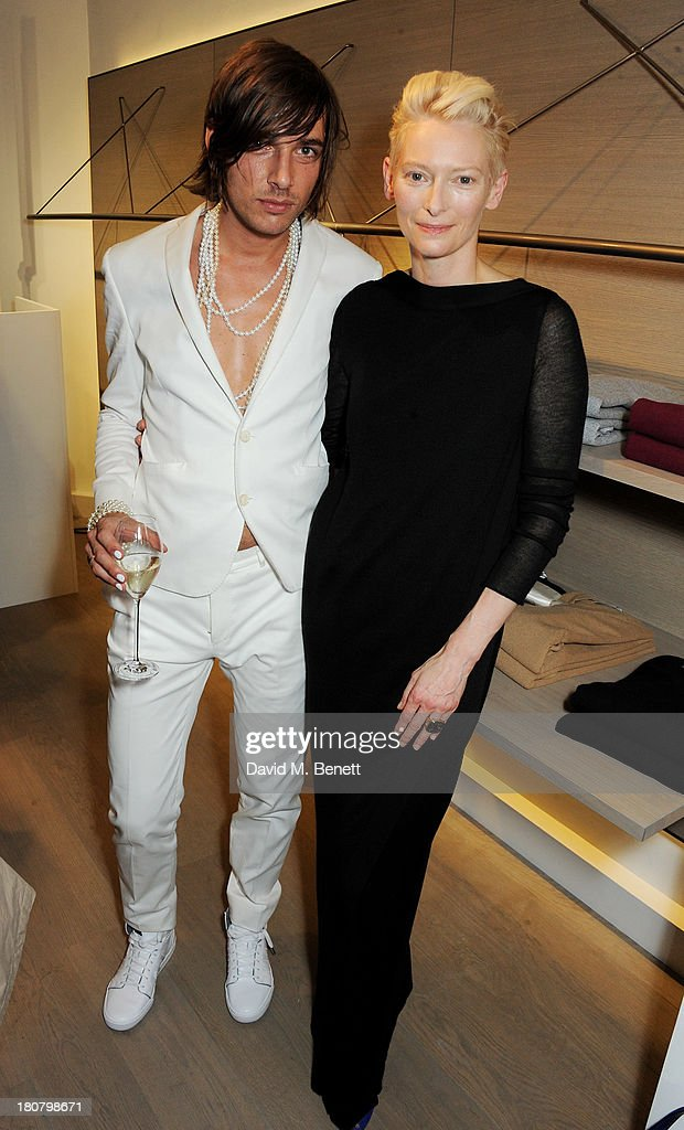 Tilda Swinton (R) and guest attend the Pringle of Scotland flagship store launch on September 16, 2013 in London, England.
