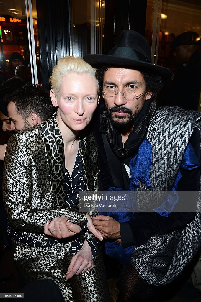 Tilda Swinton and Haider Ackermann attend the Bulgari And Purple Magazine Party at Cafe de Flore on March 3, 2013 in Paris, France.