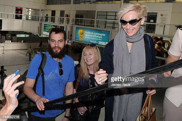 Tilda Swinton and Sandro Kopp are seen arriving at Nice Airport during 65th Cannes Film Festival on May 17 2012 in Nice France