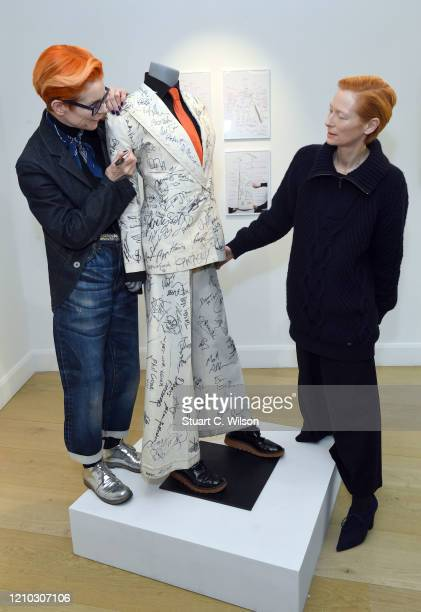 Tilda Swinton and Sandy Powell attend the Sandy Powell Derek Jarman Suit Private View at Phillips Auction House on March 04 2020 in London England