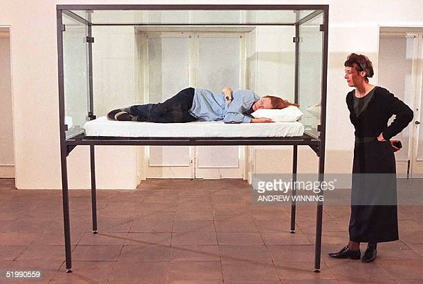 """Tilda Swinton, artist and actress famous for her role in the film """"Orlando"""", sleeps in a glass box as part of an exhibition called """"The Maybe"""" at the..."""