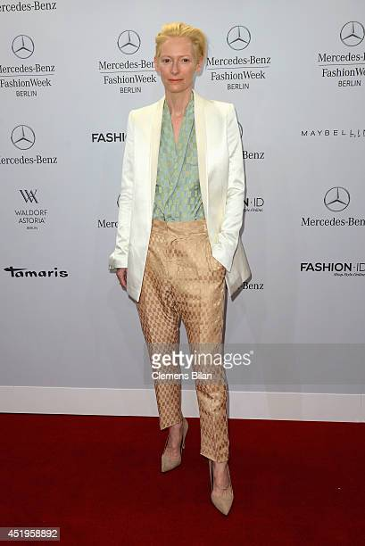 Tilda Swinton attends the Roshi Porkar show during the MercedesBenz Fashion Week Spring/Summer 2015 at Erika Hess Eisstadion on July 10 2014 in...