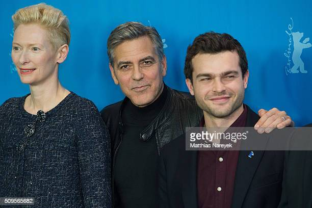 Tilda Swinton George Clooney and Alden Ehrenreich attend the 'Hail Caesar' photo call during the 66th Berlinale International Film Festival Berlin at...
