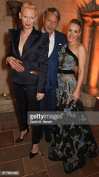 Tilda Swinton Mads Mikkelsen and Rachel McAdams attend Marvel Studios and British GQ hosted reception in The Cloisters at Westminster Abbey to...