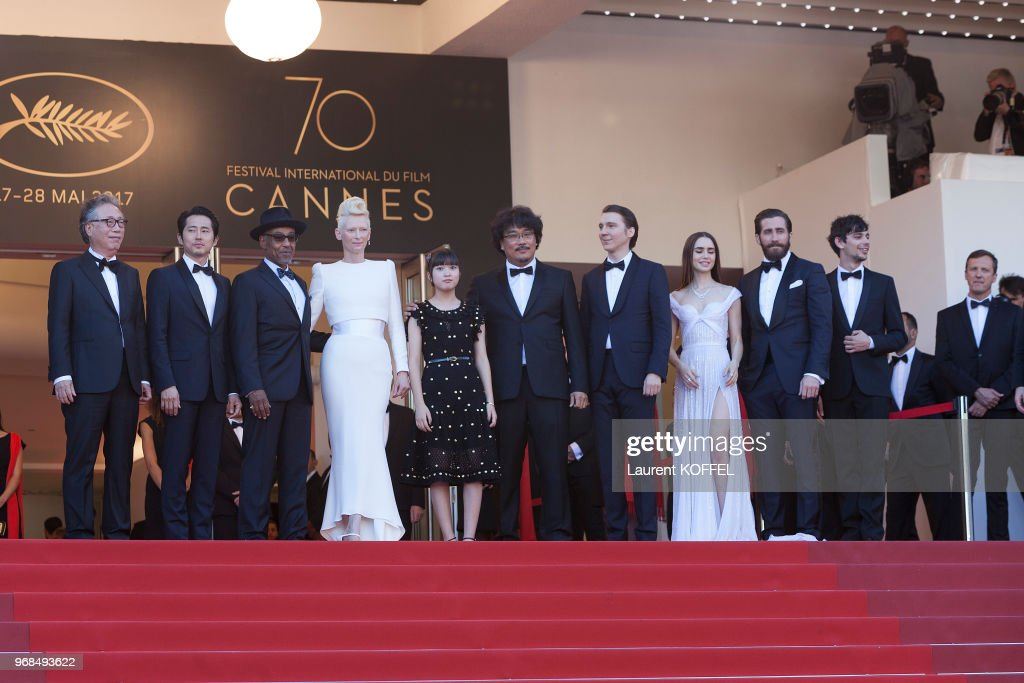 Tilda Swinton, Paul Dano, Byung Heebong, Ahn Seo-Hyun, director Bong Joon-Ho, actress Lily Collins, Steven Yeun, Devon Bostic, Giancarlo Esposito and Jake Gyllenhaal attend the 'Okja' screening during the 70th annual Cannes Film Festival at Palais des Festivals on May 19, 2017 in Cannes, France.