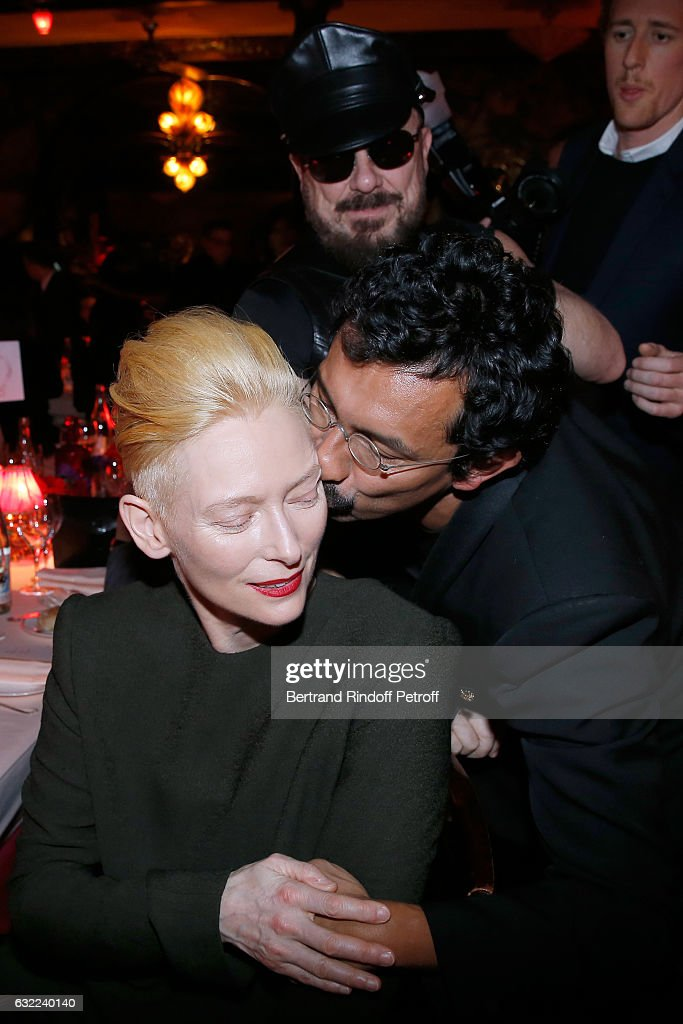 Tilda Swinton, Peter Marino and Stylist of Berluti Men, Haider Ackermann attend the Berluti Dinner as part of Paris Fashion Week - Menswear F/W 2017-2018. Held at Maxim's on January 20, 2017 in Paris, France.