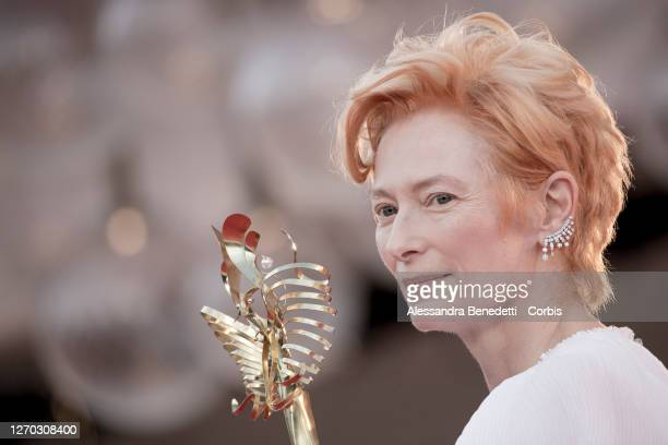 """Tilda Swinton walks the red carpet ahead of the Opening Ceremony and the """"Lacci"""" red carpet during the 77th Venice Film Festival on September 02,..."""