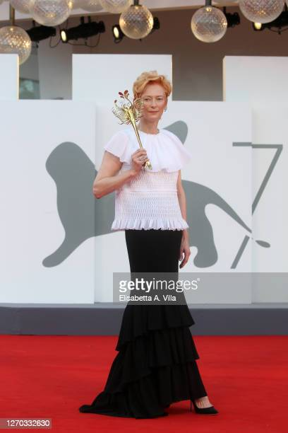"""Tilda Swinton walks the red carpet ahead of the Opening Ceremony and the """"Lacci"""" red carpet during the 77th Venice Film Festival at on September 02,..."""
