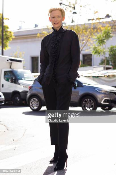 Tilda Swinton, wearing a black blouse, black trousers and black heels, is seen after the Haider Ackermann show on September 29, 2018 in Paris, France.