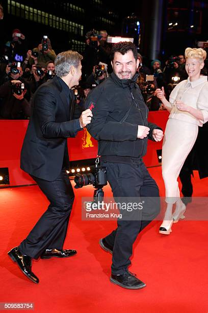 Tilda Swinton wearing Chanel and George Clooney joke with a photographer during the 'Hail Caesar' premiere during the 66th Berlinale International...