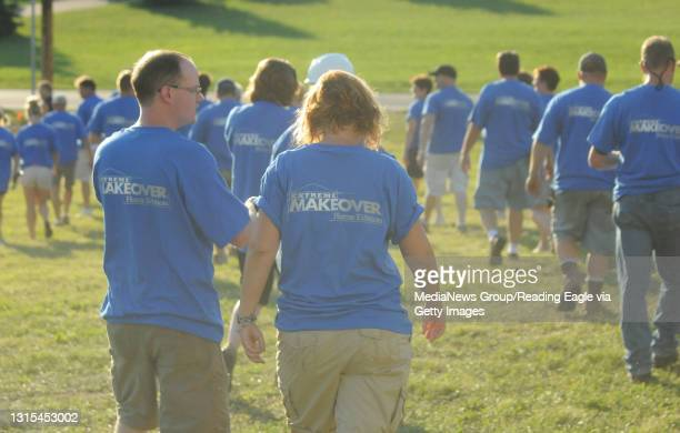Tilden Township, PAA group of volunteers wearing blue Extreme Makeover Home Edition t-shirts.At the home of Trisha Urban in Tilden Township, where...