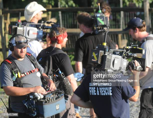 Tilden Township, PAMembers of the television crew stand outside Trisha Urban's home.At the home of Trisha Urban in Tilden Township, where her house...