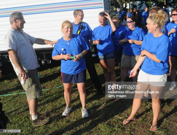 Tilden Township, PAPaul DiMeo, a designer on the show, talks with volunteers during a break in the shooting.At the home of Trisha Urban in Tilden...