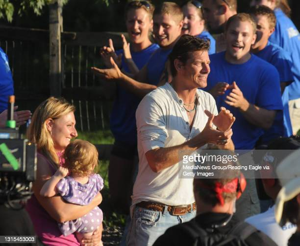 Tilden Township, PATrisha Urban, holding her daughter Cora, and Ty Pennington, the host of Extreme Makeover Home Edition. Behind them are volunteers...