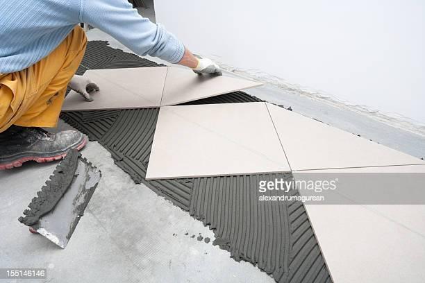 fliesenboden - installieren stock-fotos und bilder