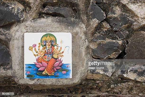 A tile of the mother godess on a wall